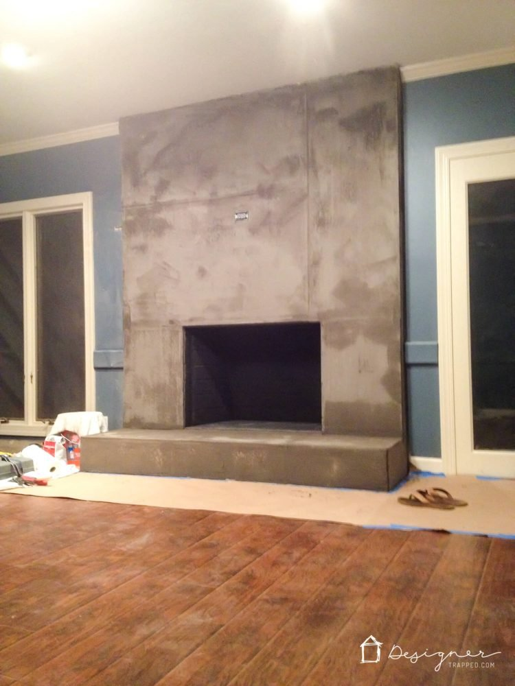 You can create a contemporary DIY concrete fireplace! We did it with some elbow grease and less than $100. Come learn how with this detailed tutorial.