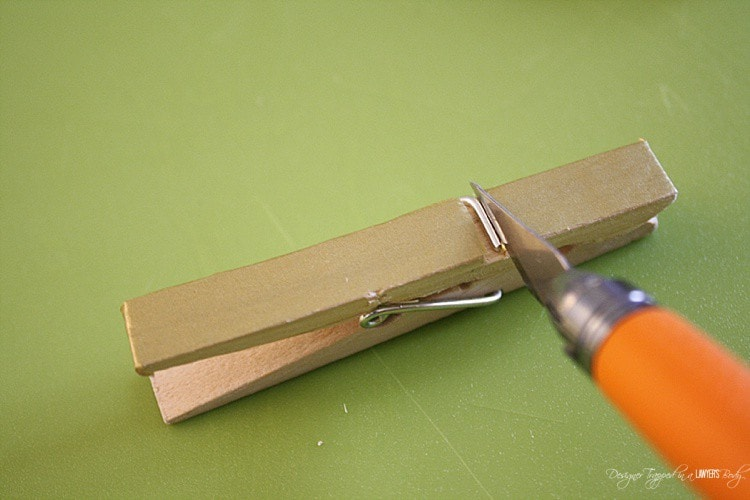Use your utility knife to expose the metal part of the clothes pin.