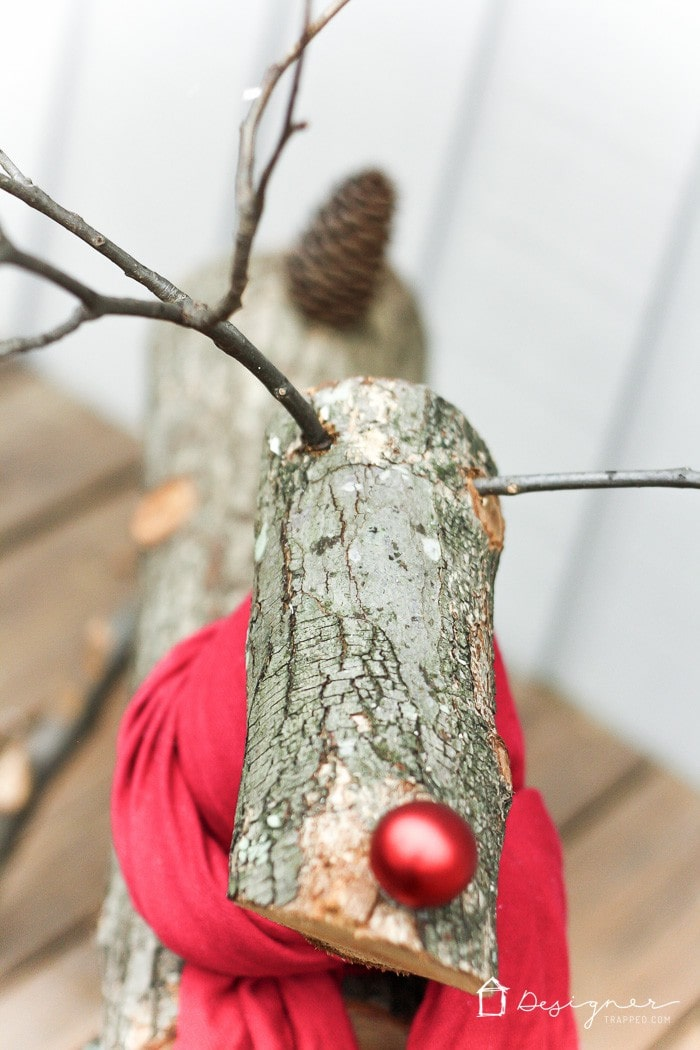 THIS IS SO CUTE! A DIY reindeer made from tree branches and logs! Check out this full tutorial on how to make a Christmas reindeer by Designer Trapped in a Lawyer's Body!