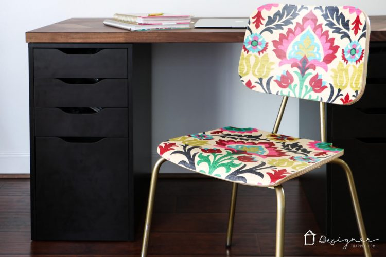 """Did you know you can decoupage furniture to get an """"upholstered"""" look on a tiny budget? Come check out how to """"upholster"""" a chair with Mod Podge and fabric!"""