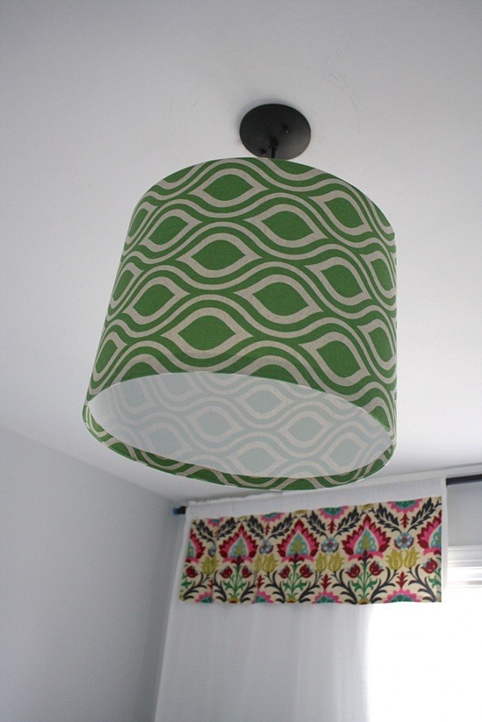 WOW! This is amazing! Learn to make your own DIY pendant light using your own fabric! Full tutorial by Designer Trapped in a Lawyer's Body.
