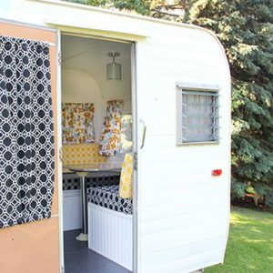Check out this top-to-bottom, fun makeover, of a vintage camper with a retro-styled look!