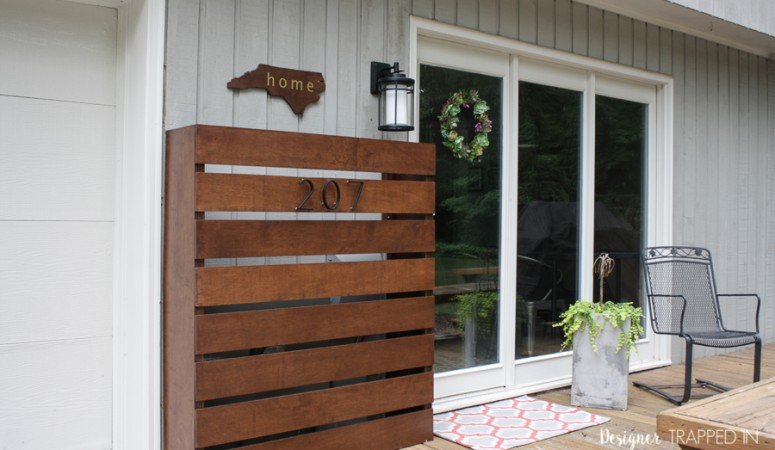 WOW! What a transformation! This back door entry went from being an eye sore to stunning and welcoming thanks to this amazing DIY utility box cover. Full reveal by Designer Trapped in a Lawyer's Body.