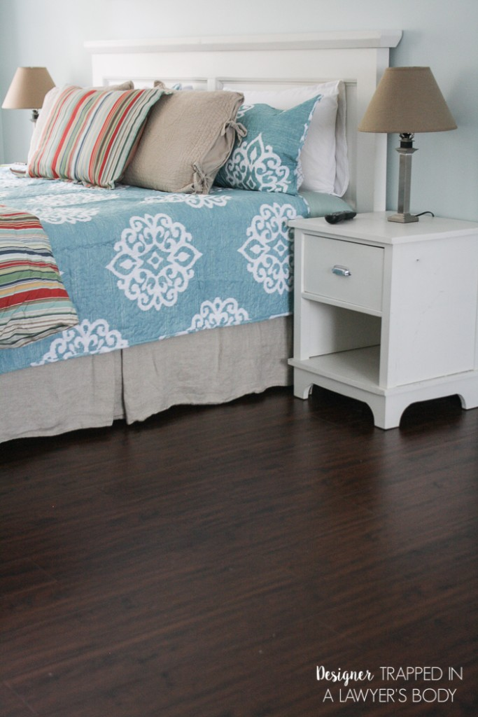 WOW! Never underestimate the power of fresh paint and new flooring! This room was totally transformed with paint and Select Surfaces laminate flooring. Come learn more at Designer Trapped in a Lawyer's Body.