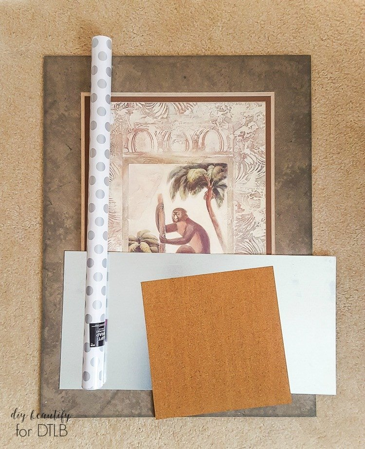 AWESOME! Learn how to make a memo board from a piece of old, ugly framed art! Full tutorial by DIY Beautify for Designer Trapped in a Lawyer's Body.