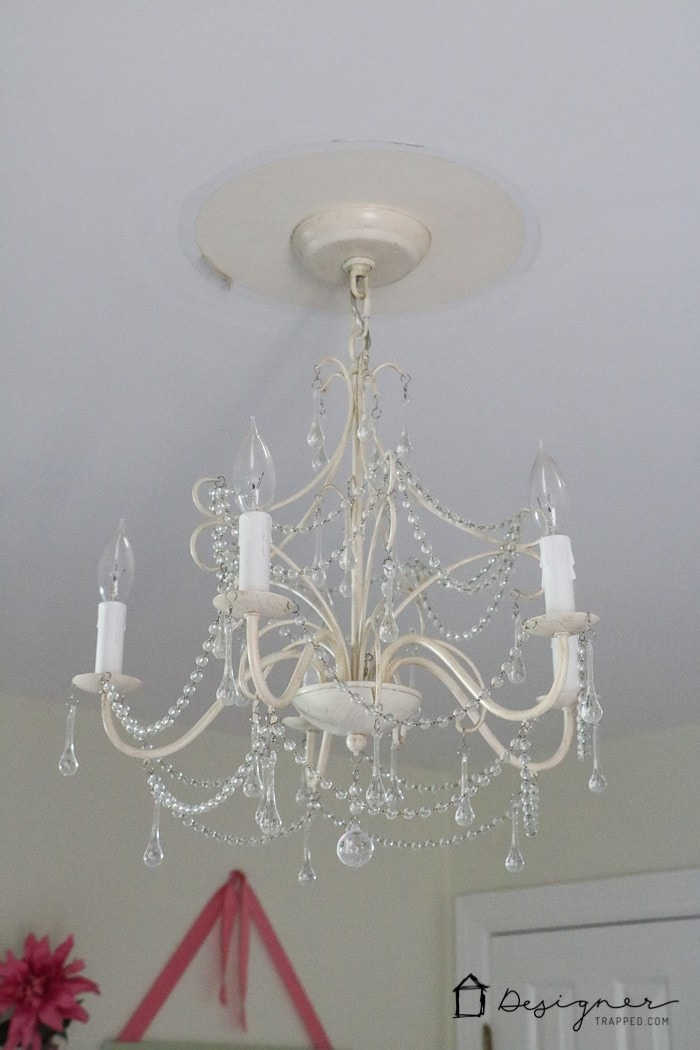 Deal with that unsightly ring left by flush mount light fixtures by  customizing your - DIY Ceiling Medallion To Hide A Ceiling Flaw Designertrapped.com