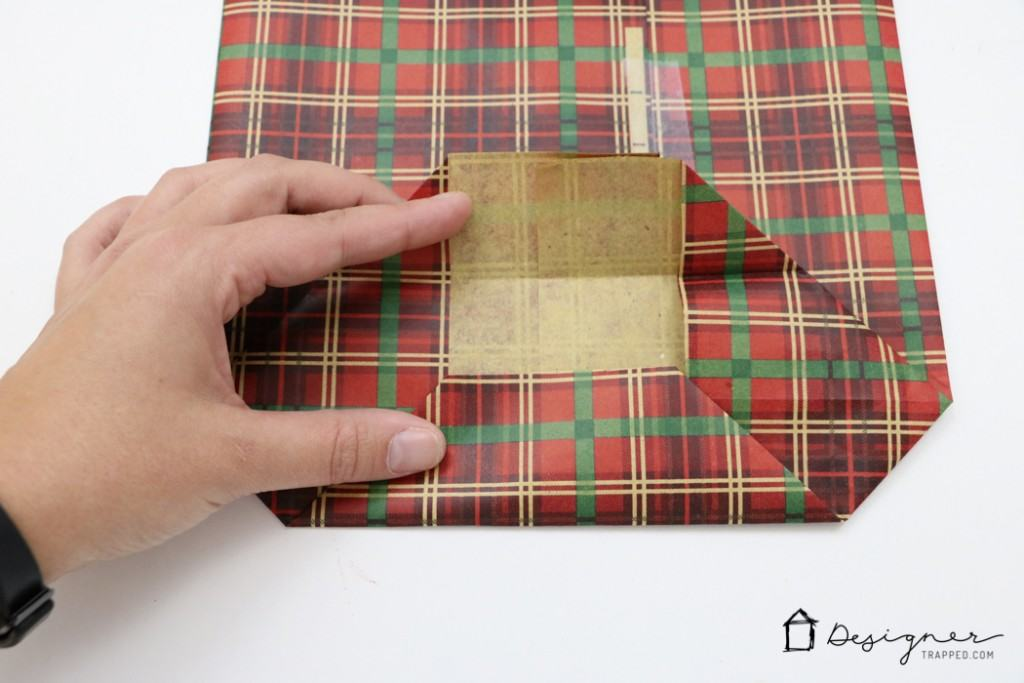 A MUST PIN FOR THE HOLIDAYS! Learn how to make a DIY gift bag from wrapping paper. It's the perfect way to wrap awkwardly shaped gifts!