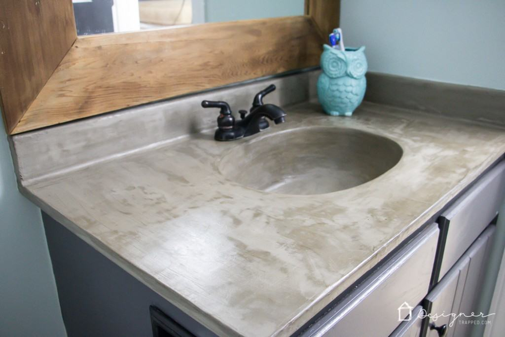 Learn how our DIY concrete vanity is holding up 18 months after completion! / DIY concrete counter top / DIY concrete sink / www.designertrapped.com