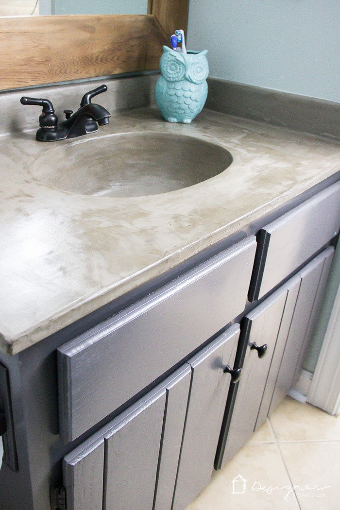 You don't have to be stuck with countertops you don't like. There are so many DIY countertops out there that can be done on a teeny, tiny budget! So many DIY countertops to choose from. This round-up shares the best DIY countertops from around the web!