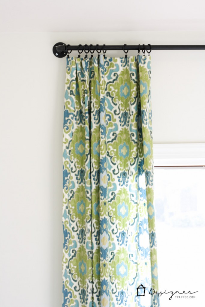 Wow! This blogger shows you how easy it is to make a gorgeous DIY curtain rod out of pipe in less than 10 minutes! | DIY curtain rod from pipe | www.designertrapped.com
