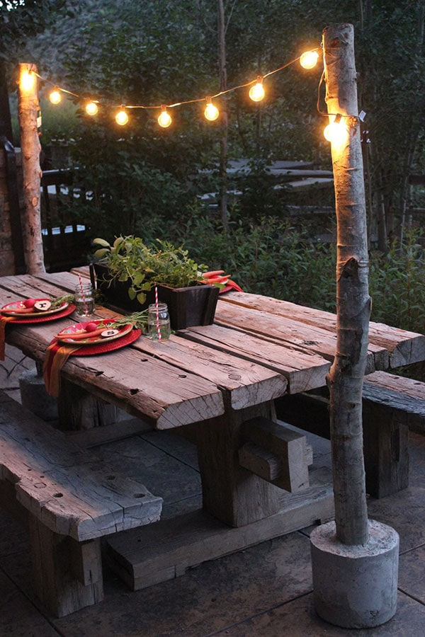 Fairy lights + utilitarian concrete + wood makes for beautiful DIY outdoor projects!