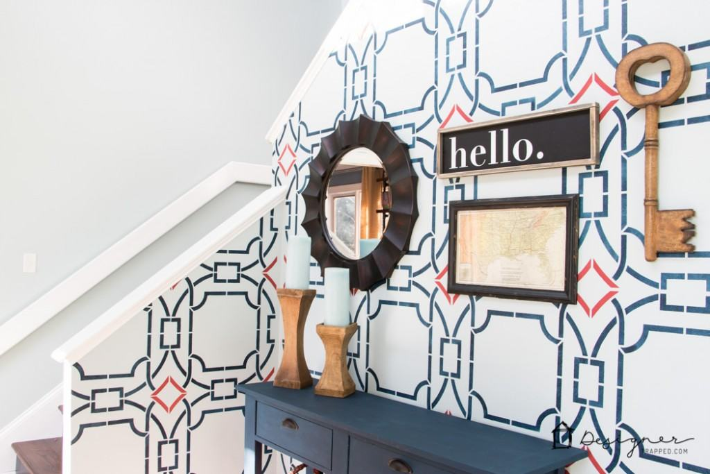 OMG, this wall is gorgeous! It's not wallpaper, it's a stencil. Learn how to stencil with this blogger's tutorial. It looks easy!