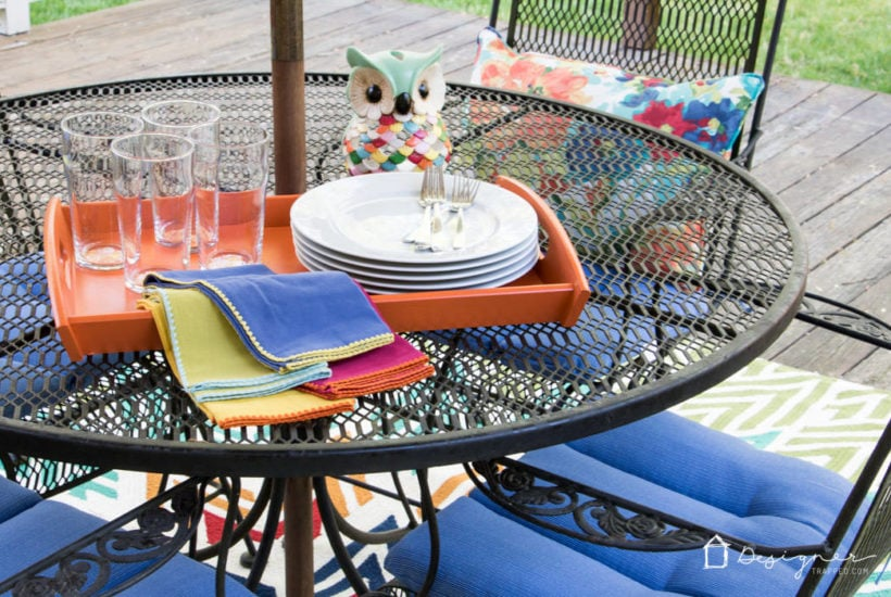 I LOVE this colorful outdoor dining area and it was created on a budget. Perfect.