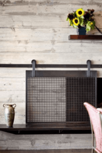 How to make a barn door style fireplace screen designertrapped omg this sliding fireplace screen is amazing best of all this bloggers tutorial solutioingenieria Choice Image