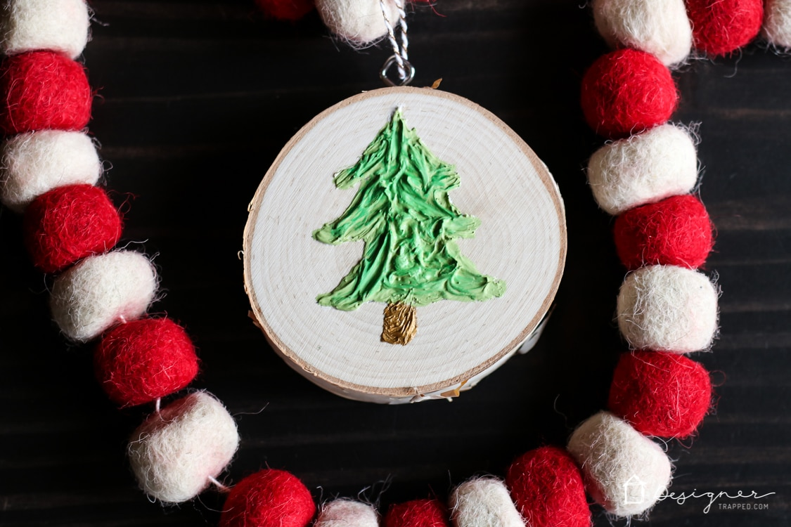 If you've ever wondered how to make Christmas ornaments that are unique and easy, this is the tutorial for you! I love how much texture the Christmas tree has--I never would have thought to use caulk!