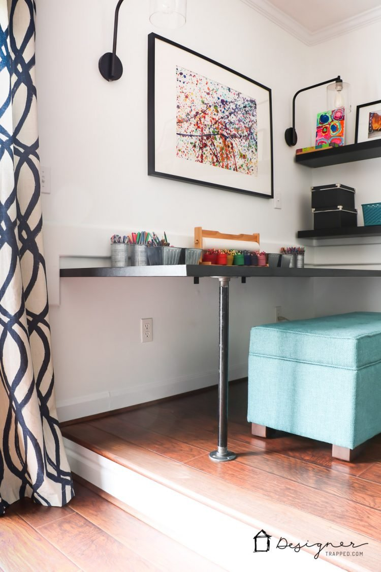 LOVE this family room design! Such a great way to combine a playroom and family room the whole family can enjoy into one space. Super smart design choices! #spon