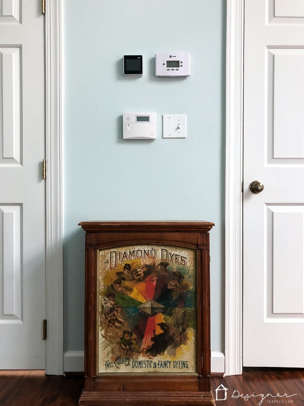 thermostat and alarm pad on wall