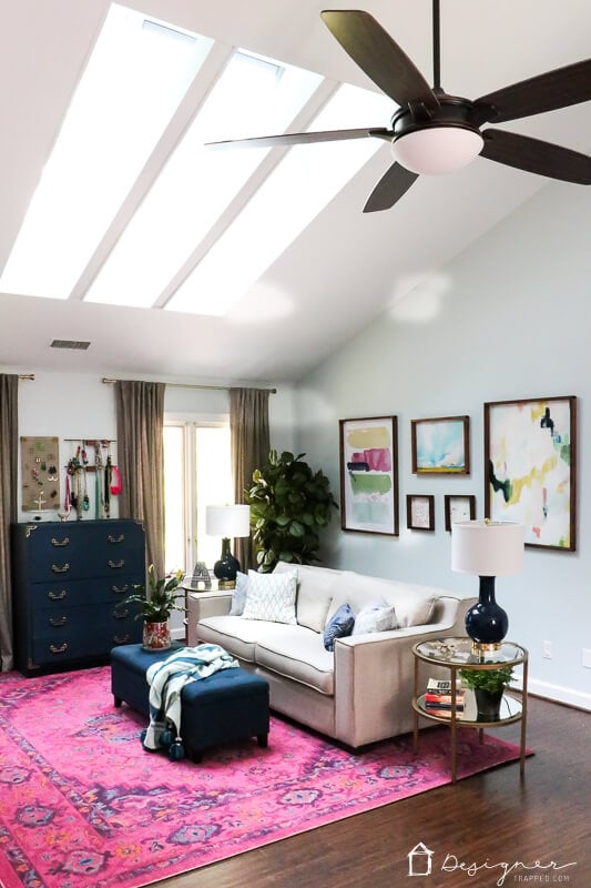 navy and pink sitting area in bedroom