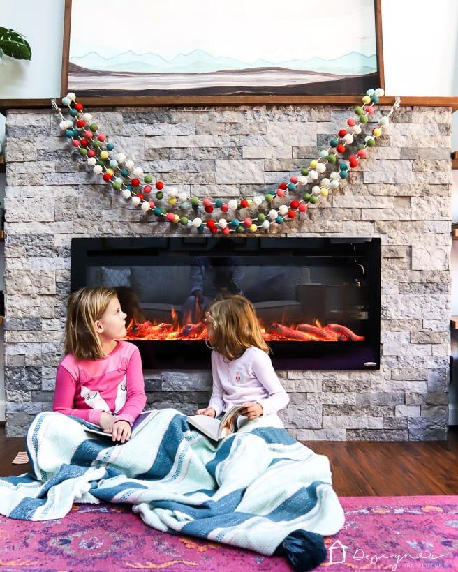 pompom garland over fireplace