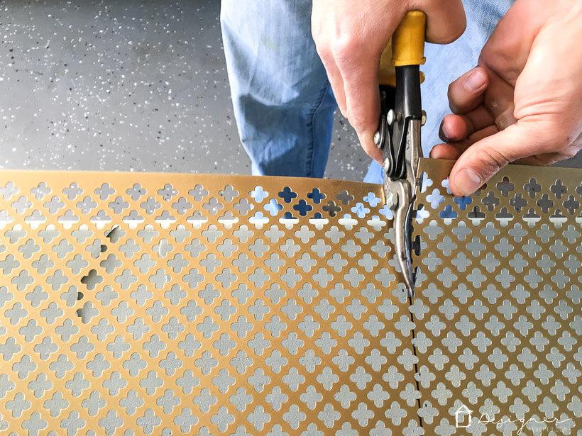 metal snips trimming metal screen